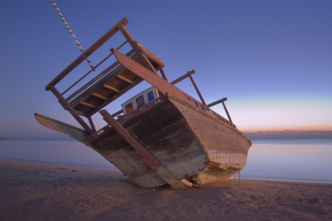 Beached dhow boat at morning dusk in Al Wakra, south from Doha. Qatar