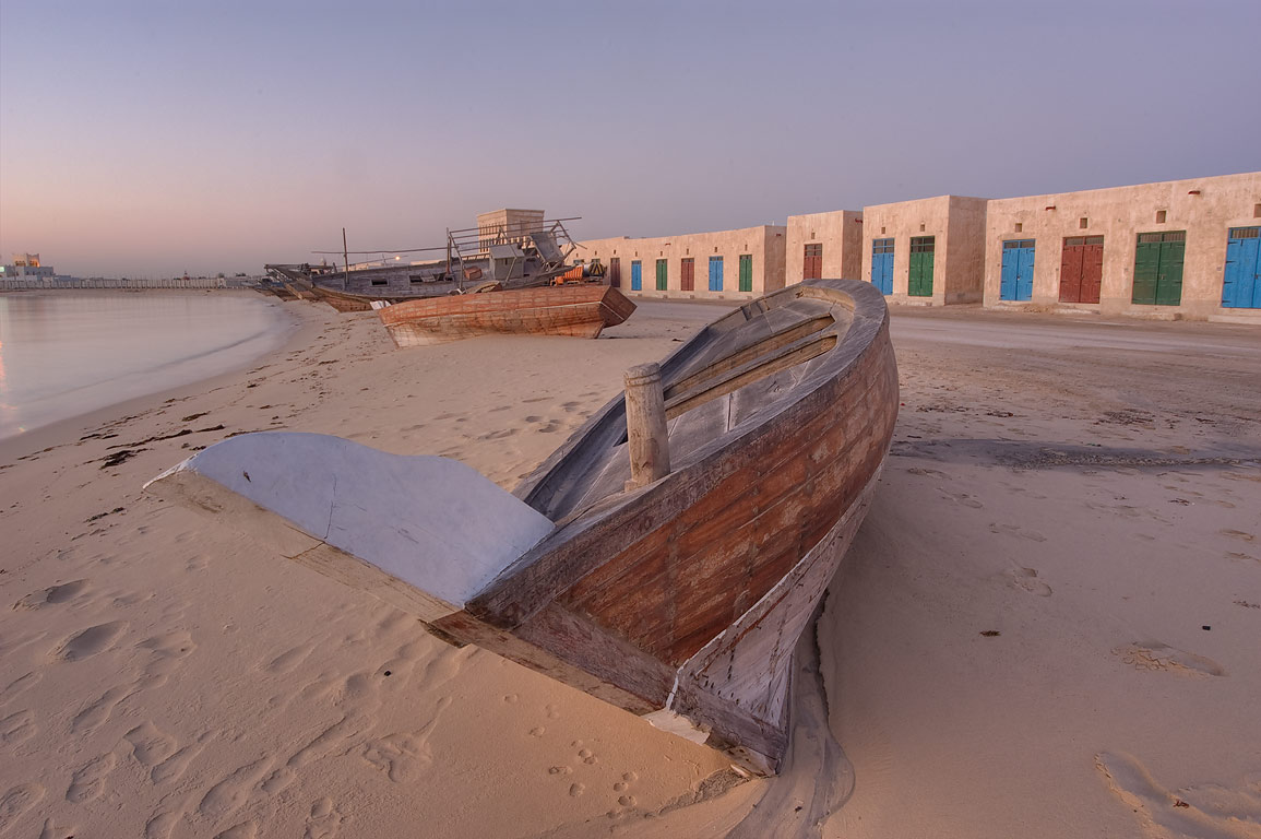 Beached fishing boats at sunrise in Al Wakra, south from Doha. Qatar
