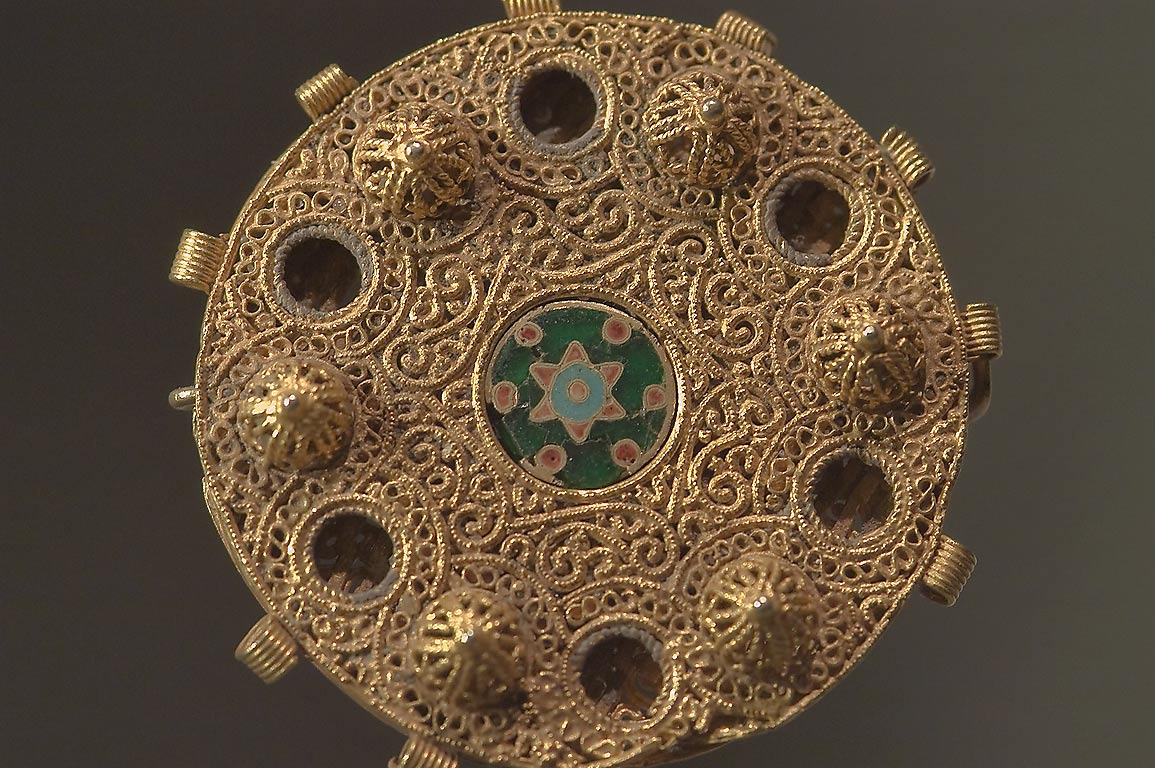 Decorated golden disc with a blue Star of David...in Museum of Islamic Art. Doha, Qatar