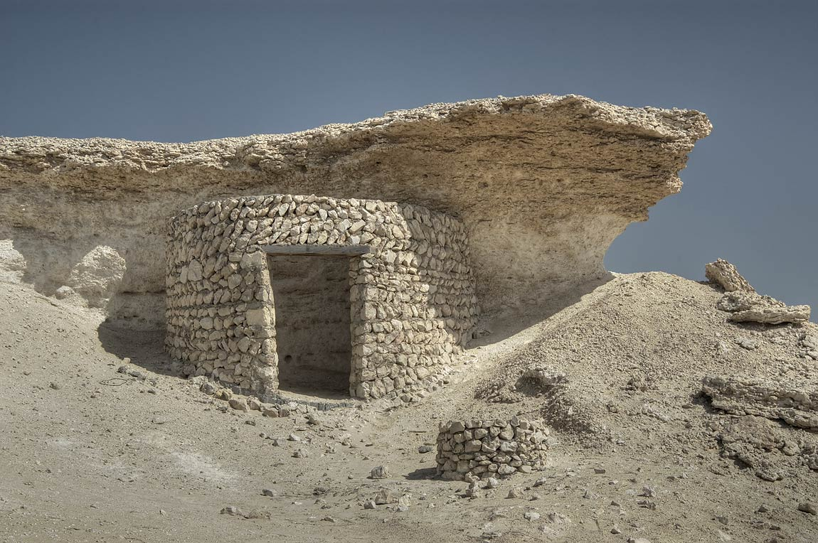 Stone huts on limestone cliffs (remnants the...area, north from Zekreet. Qatar