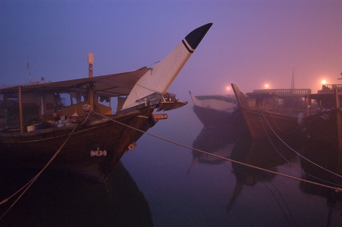 Dhow fishing boats docked in a port at morning dusk. Doha, Qatar