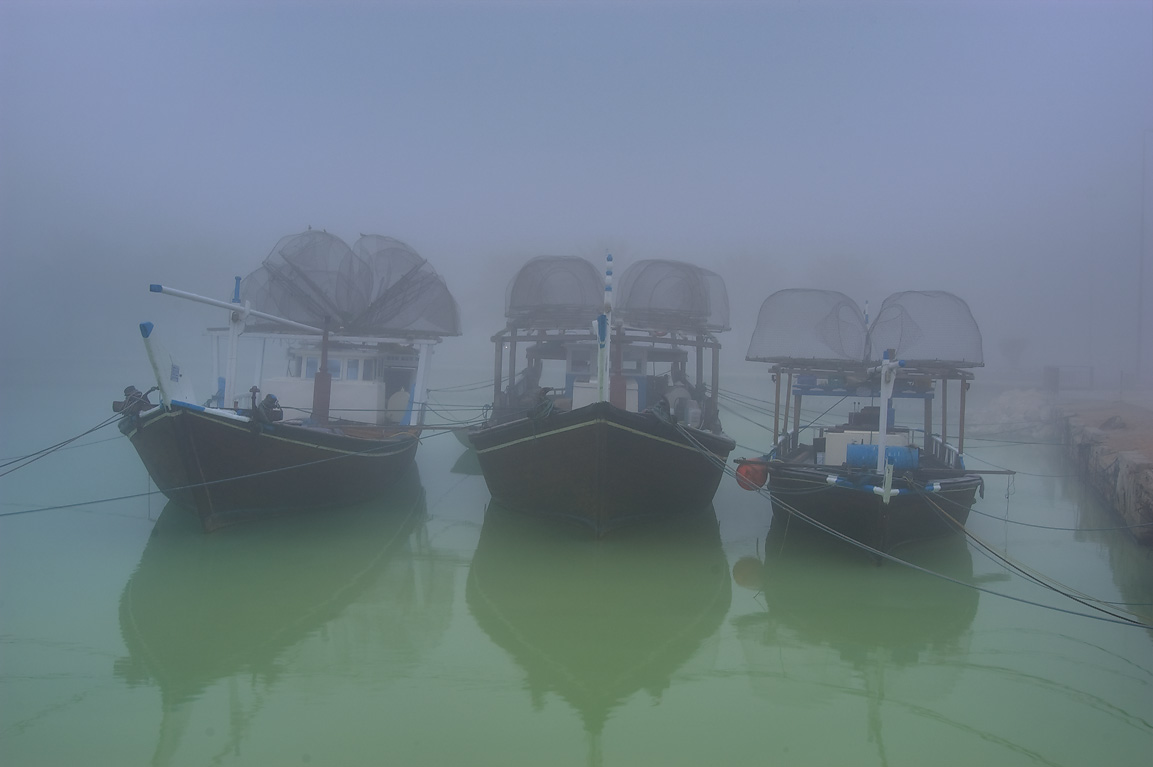 Dhow fishing boats with fish traps standing in a port at morning dusk. Doha, Qatar