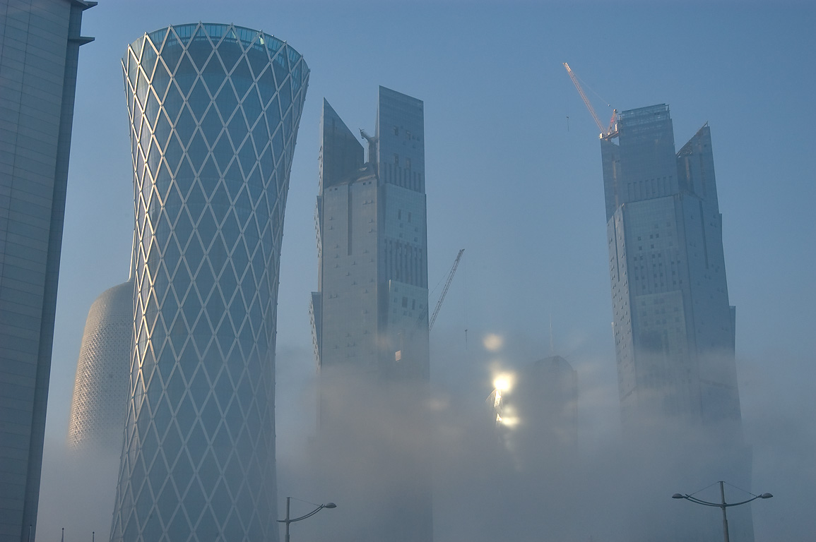 West Bay towers at morning in fog, view from Al Wahda St.. Doha, Qatar