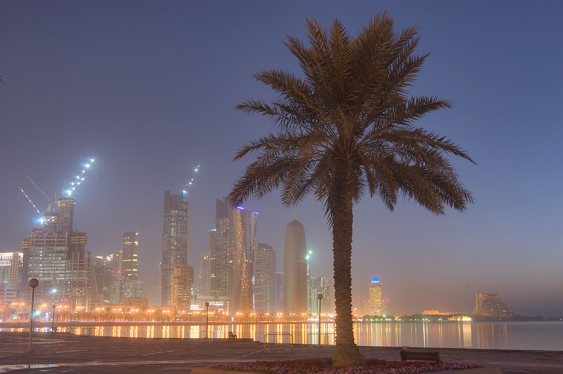 Waterfront promenade and West Bay from a square...on Corniche at morning. Doha, Qatar
