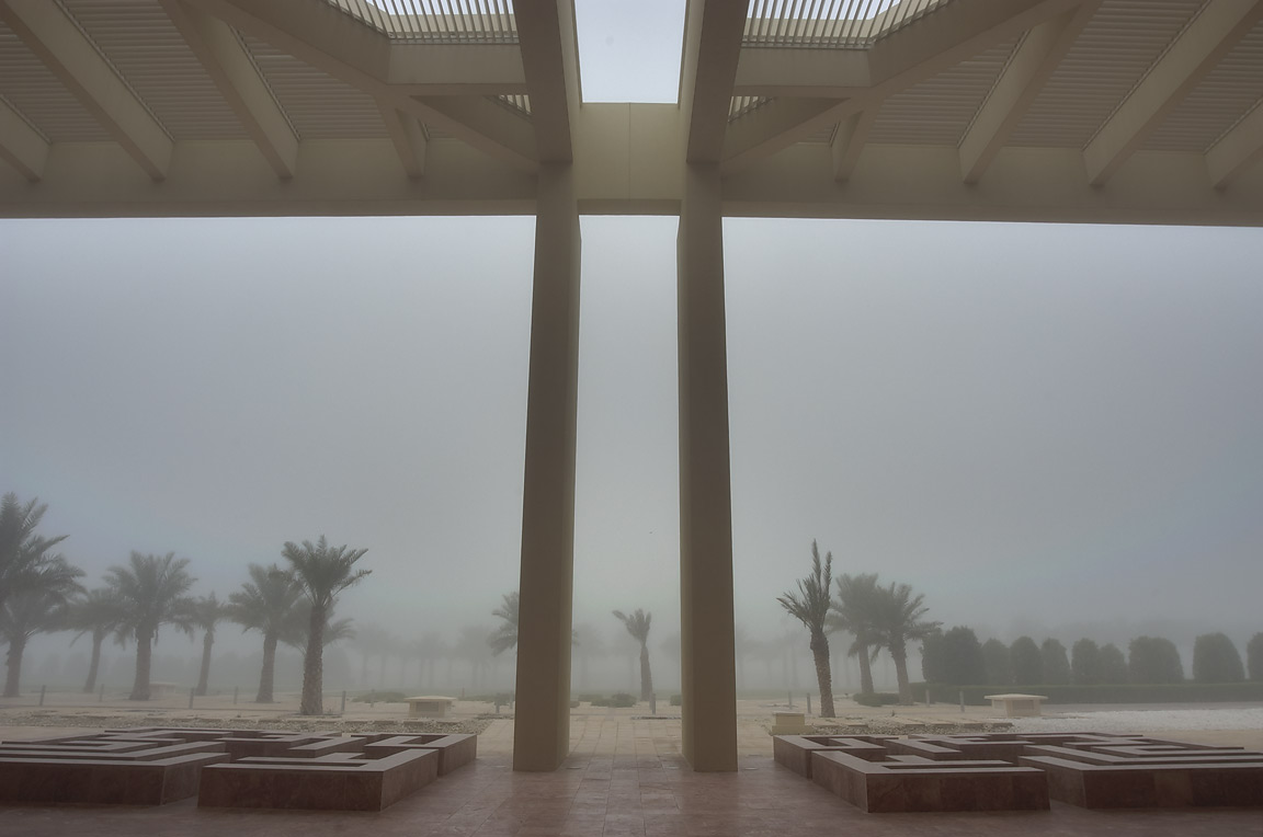 West entrance of TAMUQ research area (Texas A and...City campus in fog. Doha, Qatar