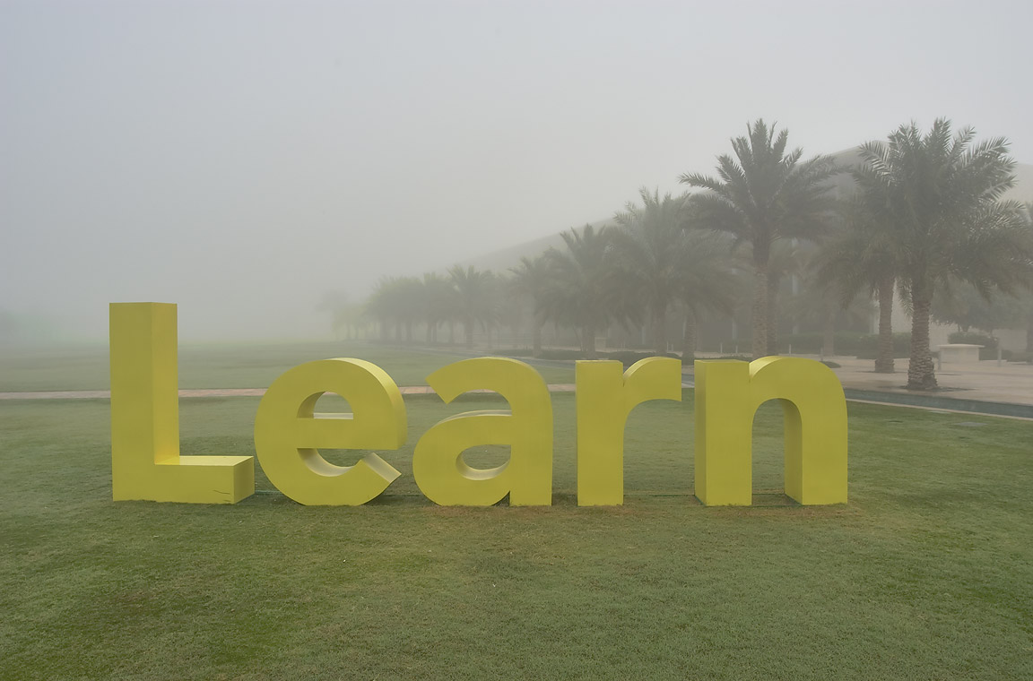 "Advice ""Learn"" on a lawn in Education City university campus. Doha, Qatar"