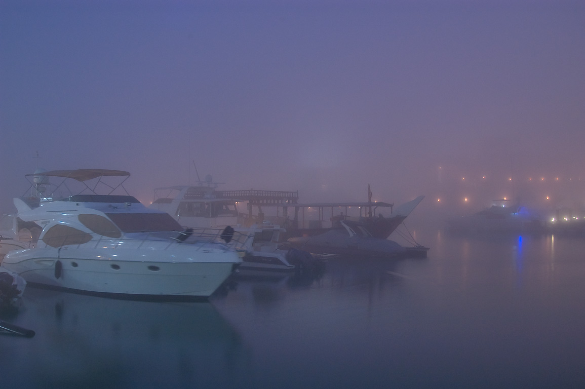 Marina of Four Seasons Hotel in West Bay in fog. Doha, Qatar