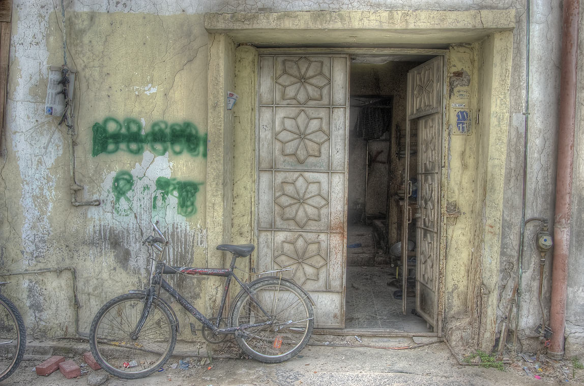 Bicycle at an apartment door in area of Al Asmakh St.. Doha, Qatar