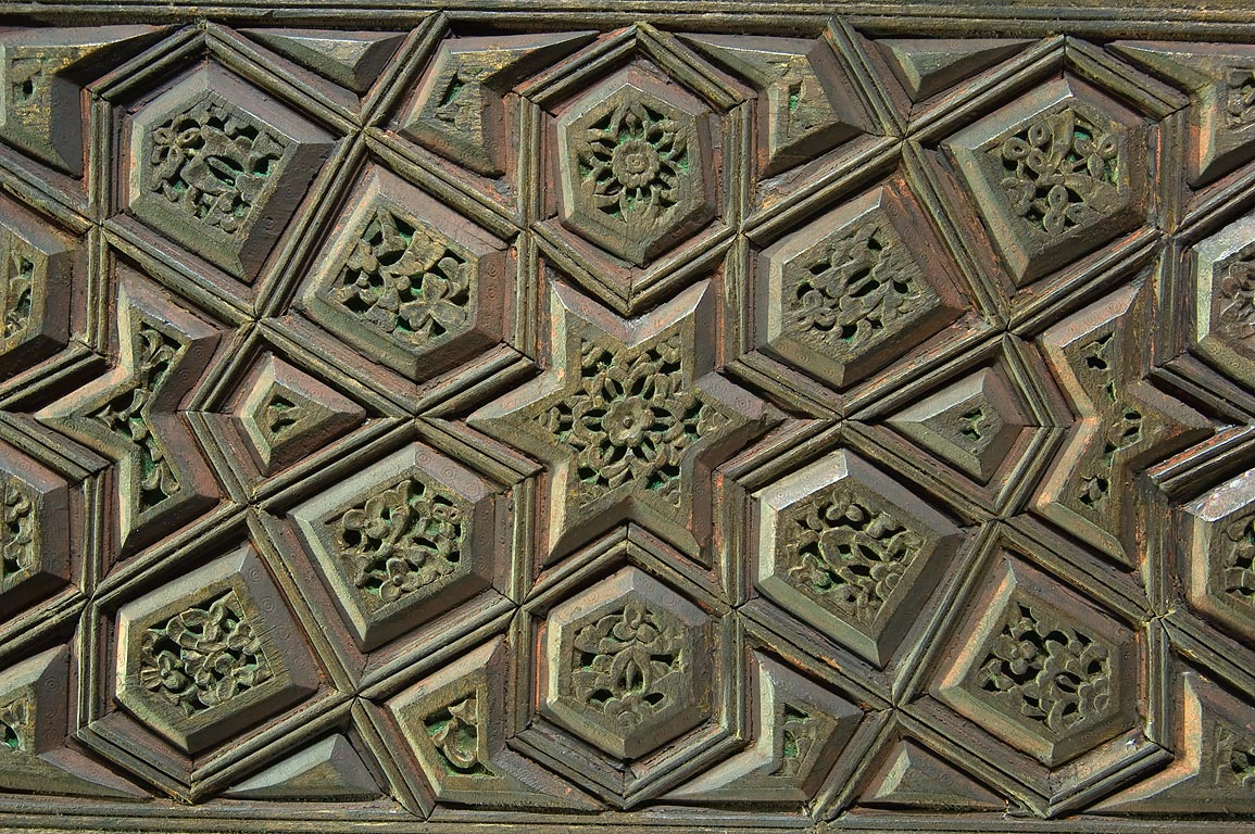 Carved wood panel with a geometric pattern on...in Museum of Islamic Art. Doha, Qatar