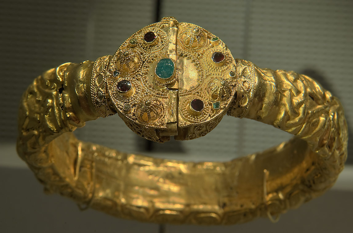 Golden bracelet with inlaid emerald on display in Museum of Islamic Art. Doha, Qatar