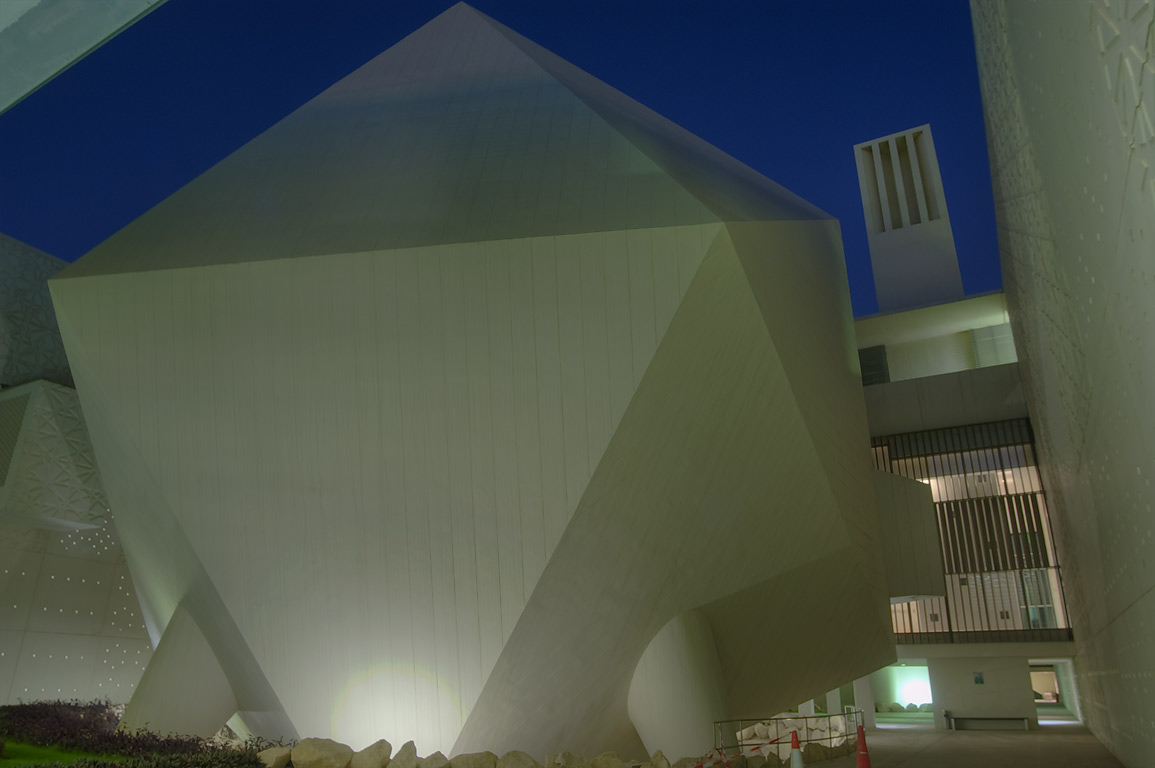 Icosahedron lecture hall and wind towers of Weill...City campus at evening. Doha, Qatar