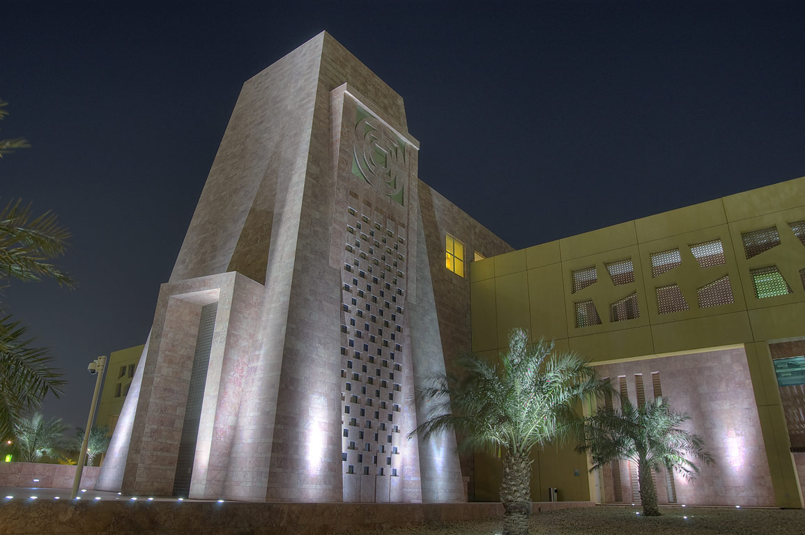 Palms at main entrance of TAMUQ (Texas A&M...City campus at evening. Doha, Qatar
