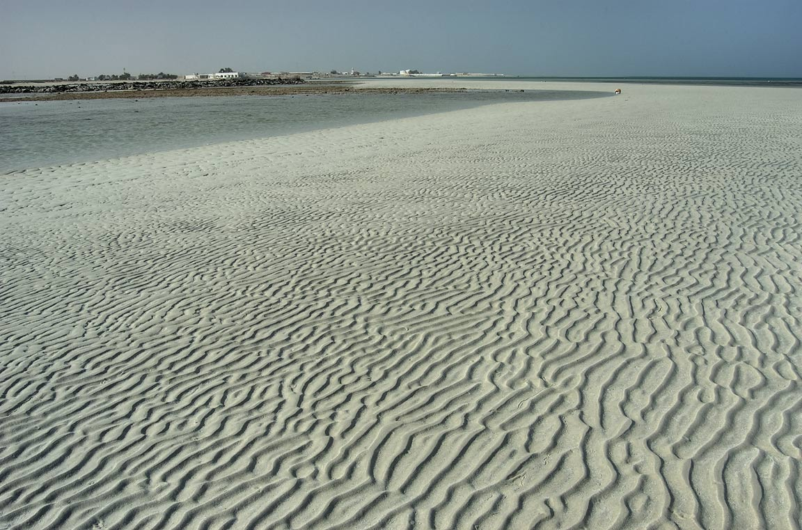 Sand ripples on a sandy bar at low tide in French...Beach), on north-eastern coast. Qatar