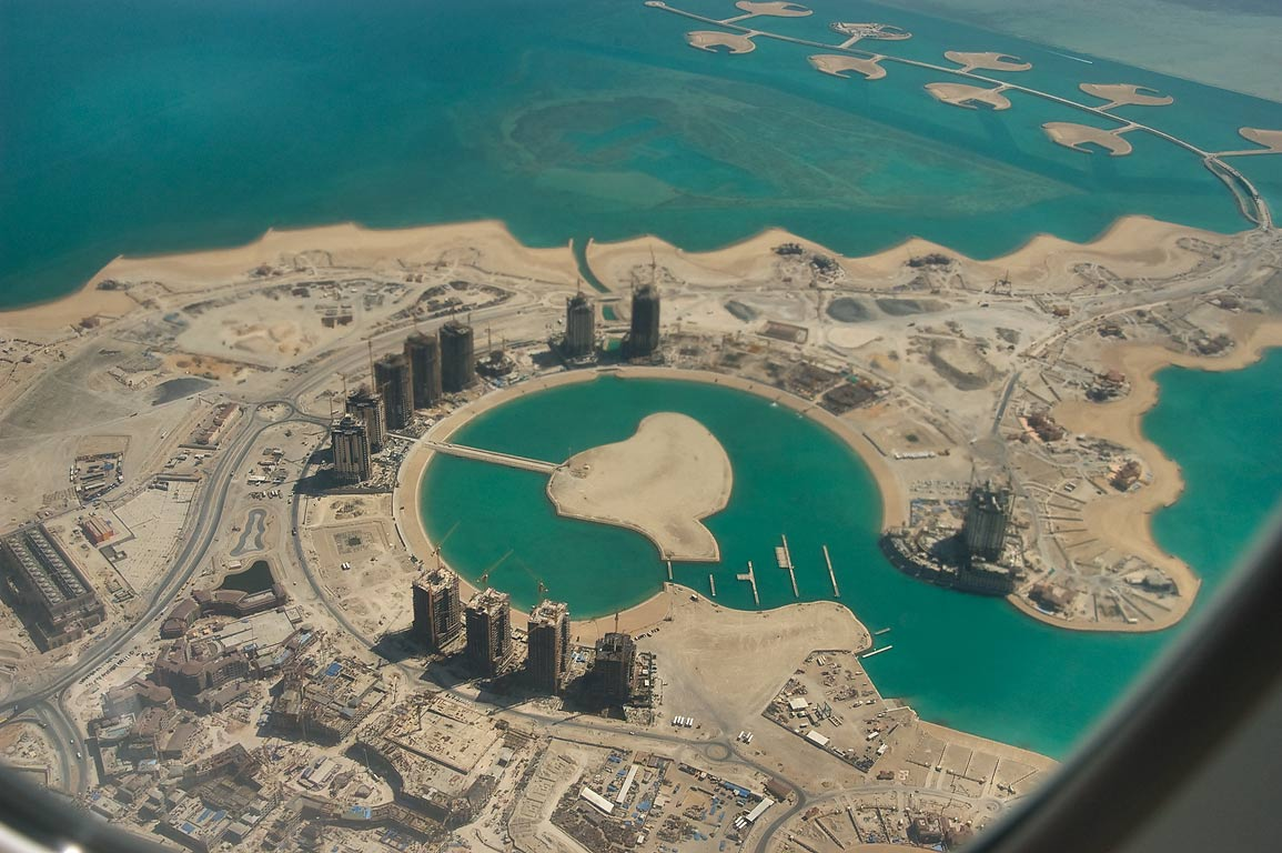 The Pearl Qatar development (artificial island in...plane from Doha, Qatar to Houston, TX