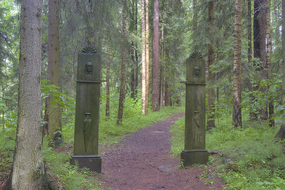 Iron funeral gates (1808-1809) in a forest near...Park, south from St.Petersburg, Russia