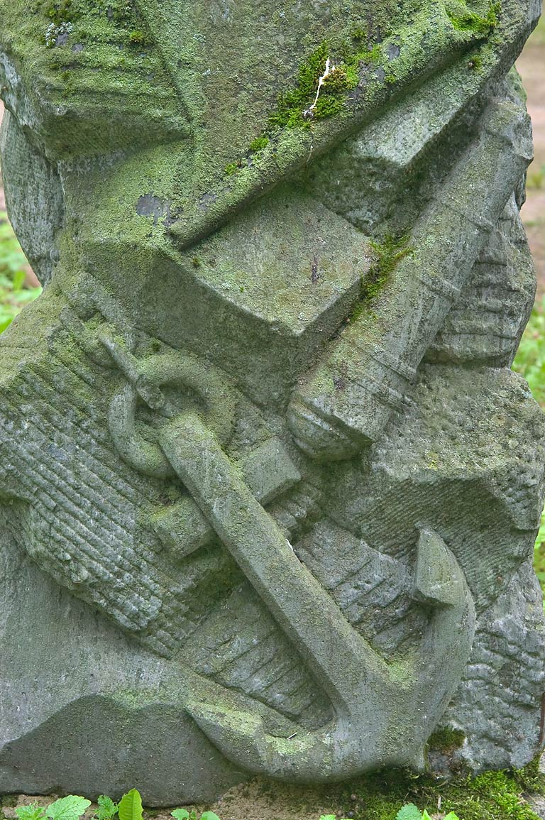 Anchor and guns on a tombstone in Novodevichye...Prospekt. St.Petersburg, Russia