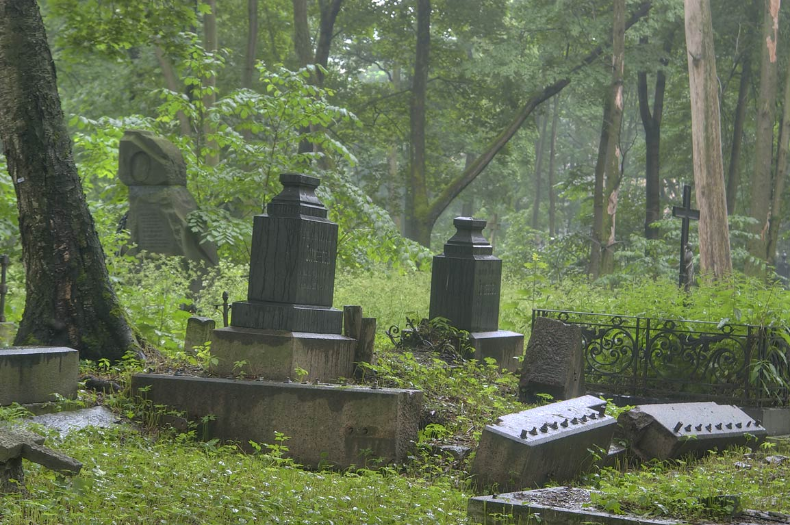 Granite tombs in Novodevichye Cemetery at...in mist. St.Petersburg, Russia