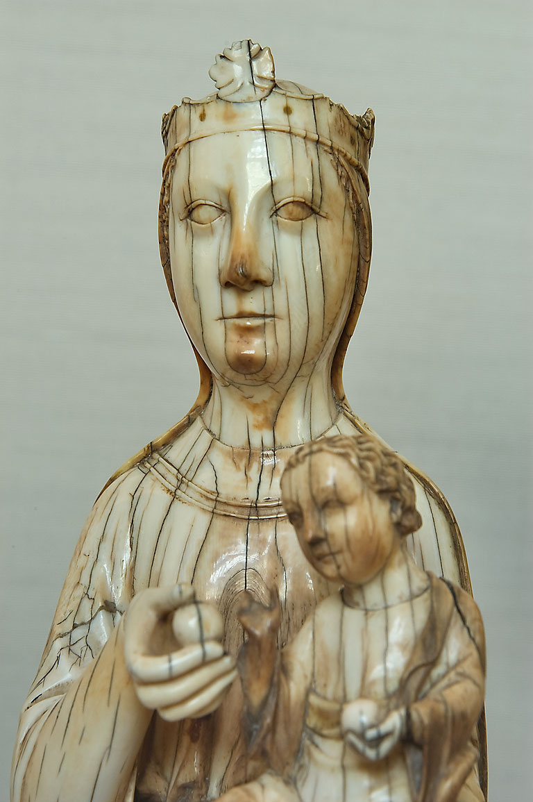 Ivory sculpture of madonna like woman with a...Museum. St.Petersburg, Russia