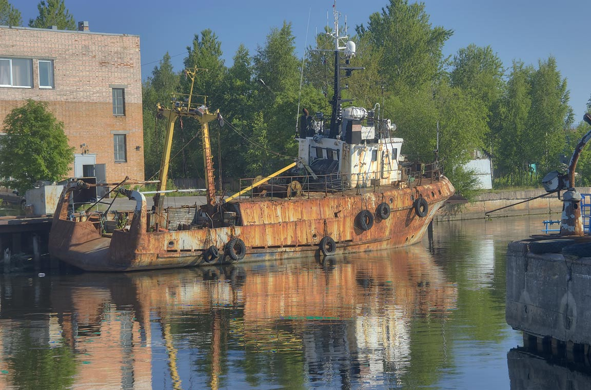 Old ship in Sidorovskiy Canal, near railroad...a suburb of St.Petersburg, Russia