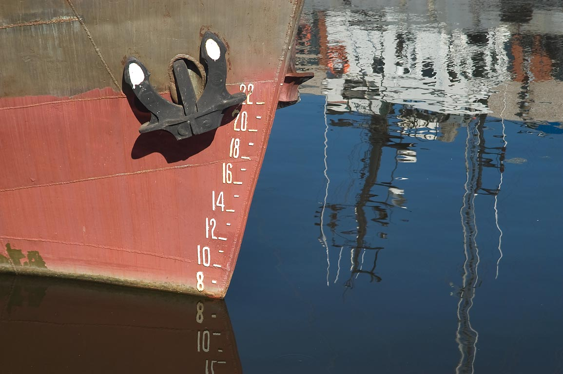 Ship reflections in Sidorovskiy Canal, near...a suburb of St.Petersburg, Russia