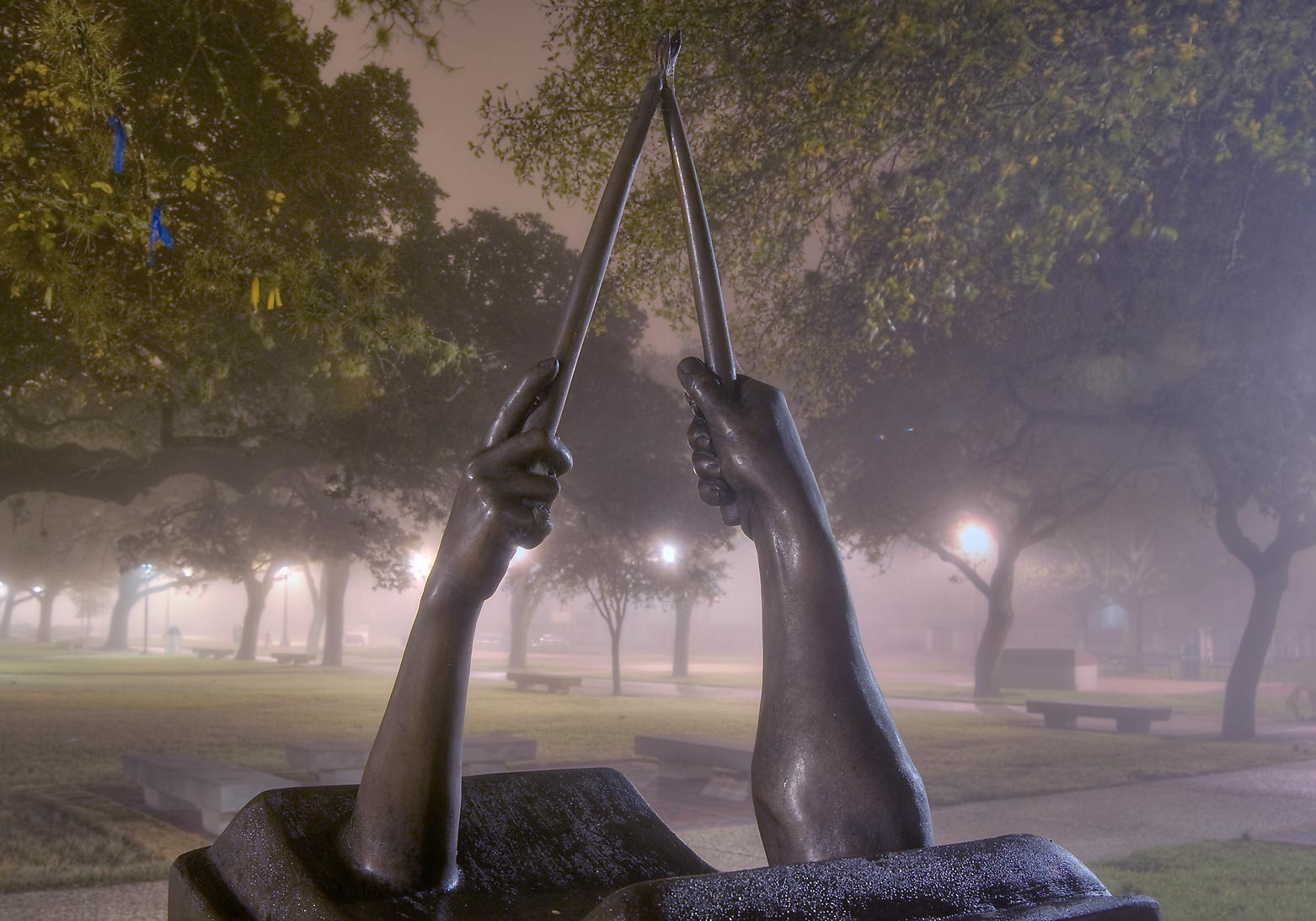 Muster sculpture in Academic Plaza on campus of...in fog. College Station, Texas