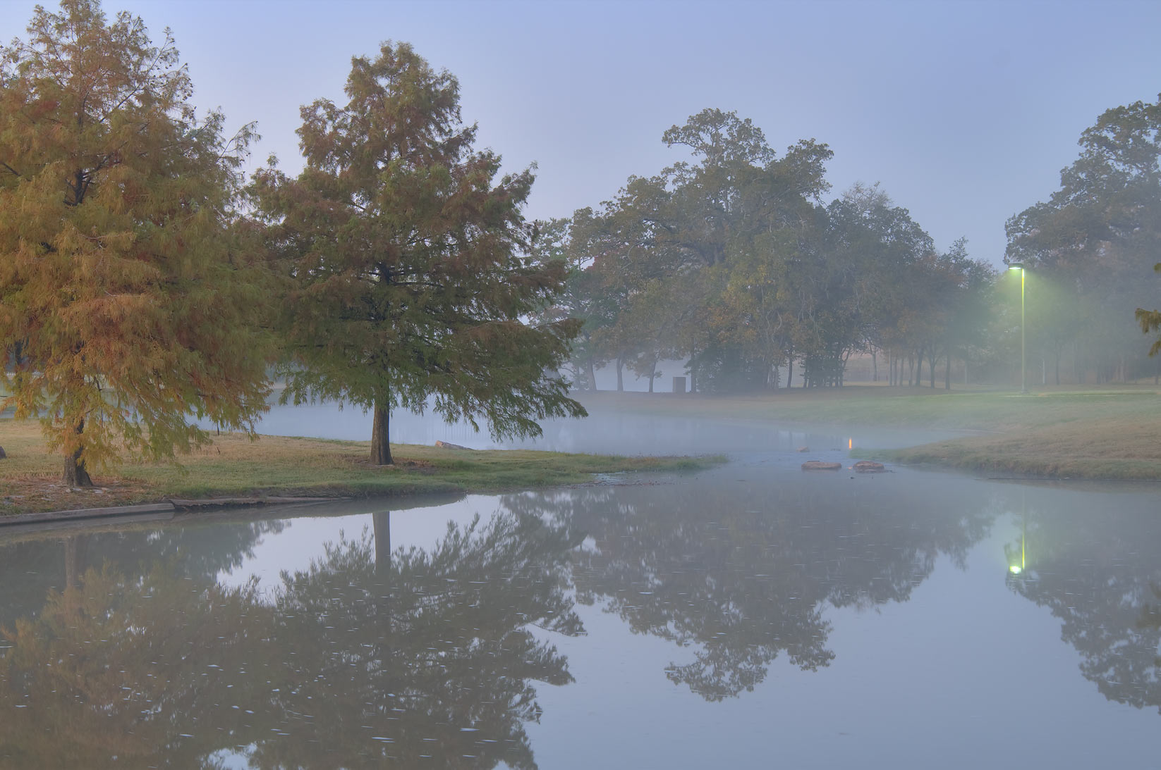 Pond of Research Park in fog on campus of Texas A&M University. College Station, Texas