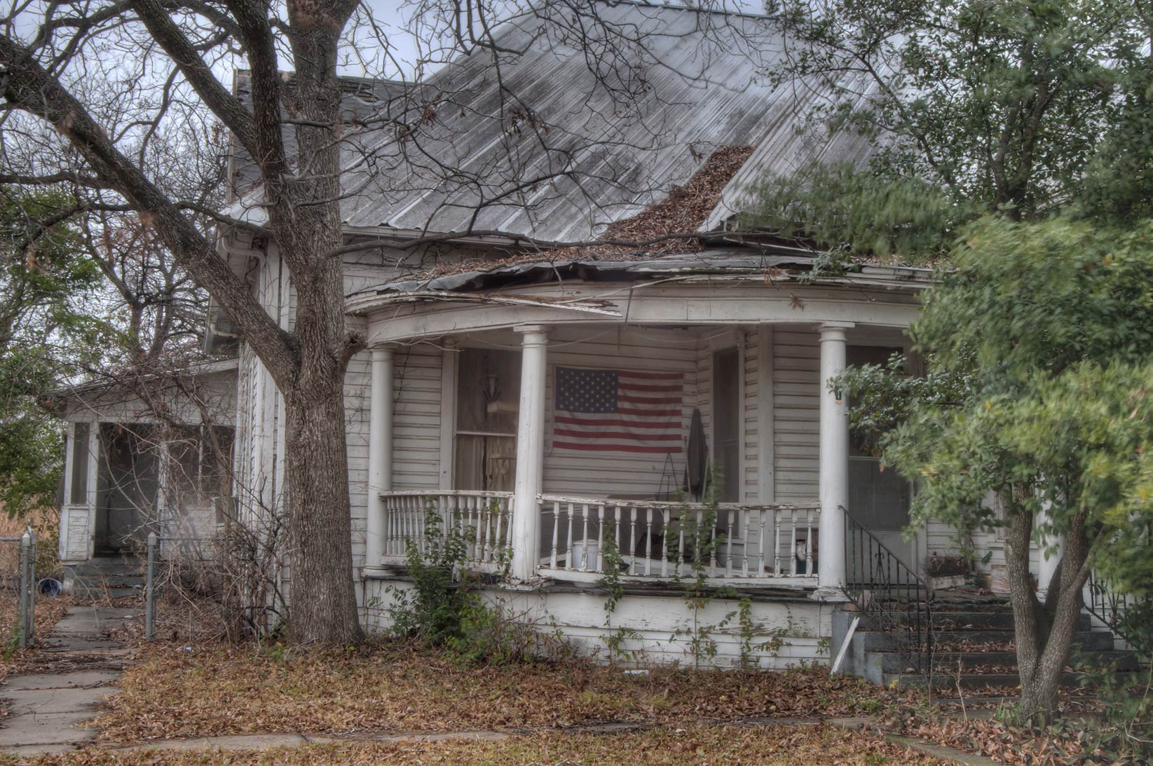 Old house at Rd. 320 (Gassaway), a corner of 5-th St. in Lott. Texas