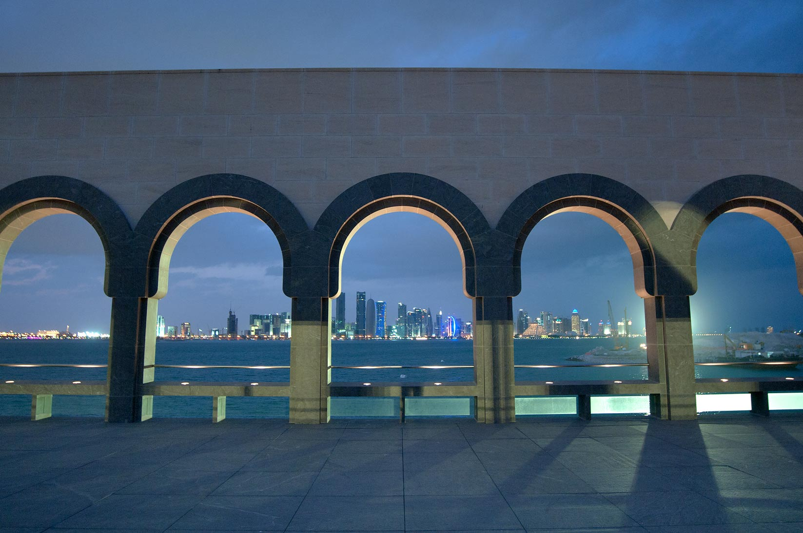 Gallery of fountain courtyard of Museum of Islamic Art at evening. Doha, Qatar