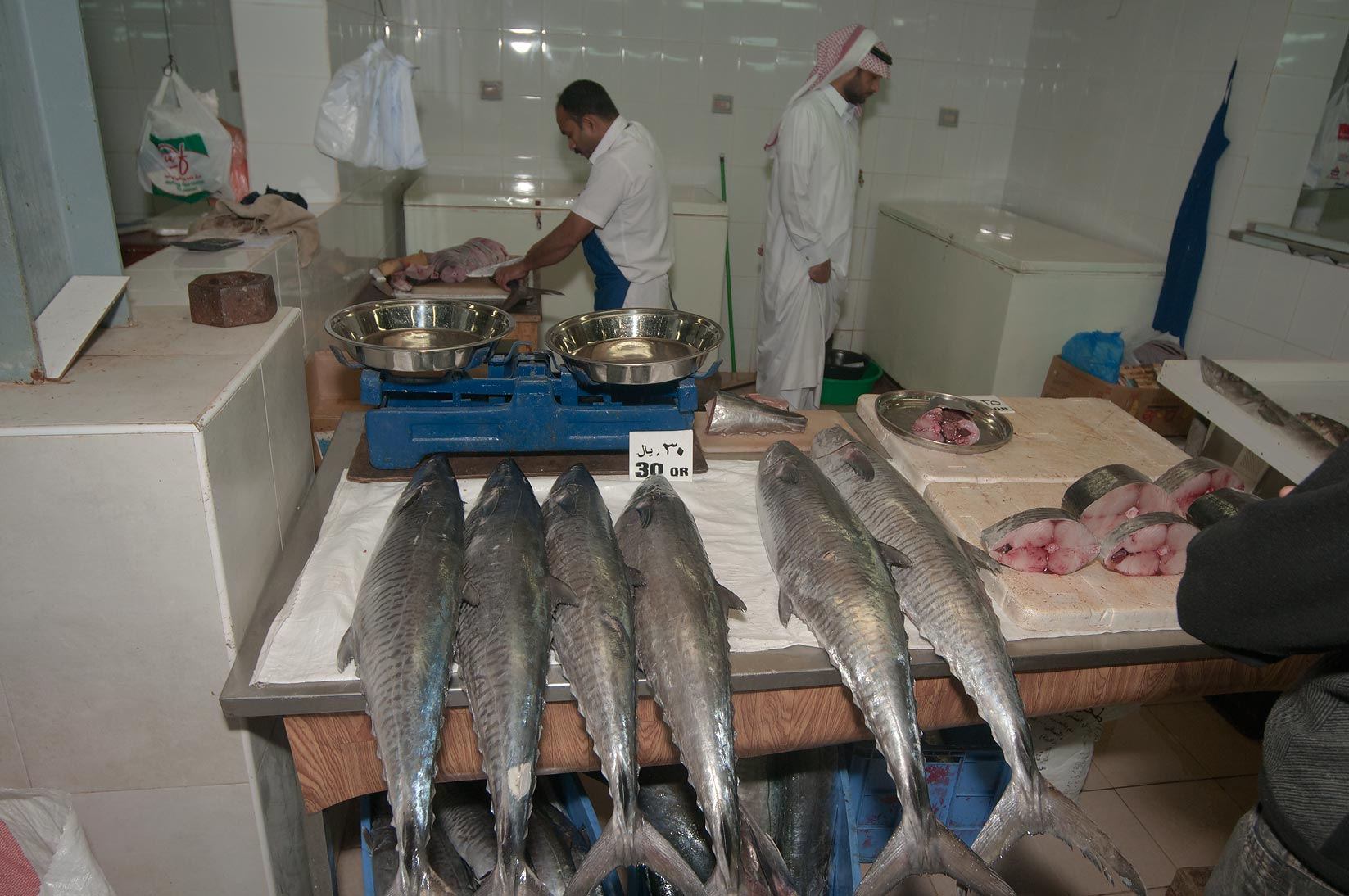 Cutting tuna in Central Fish Market. Doha, Qatar