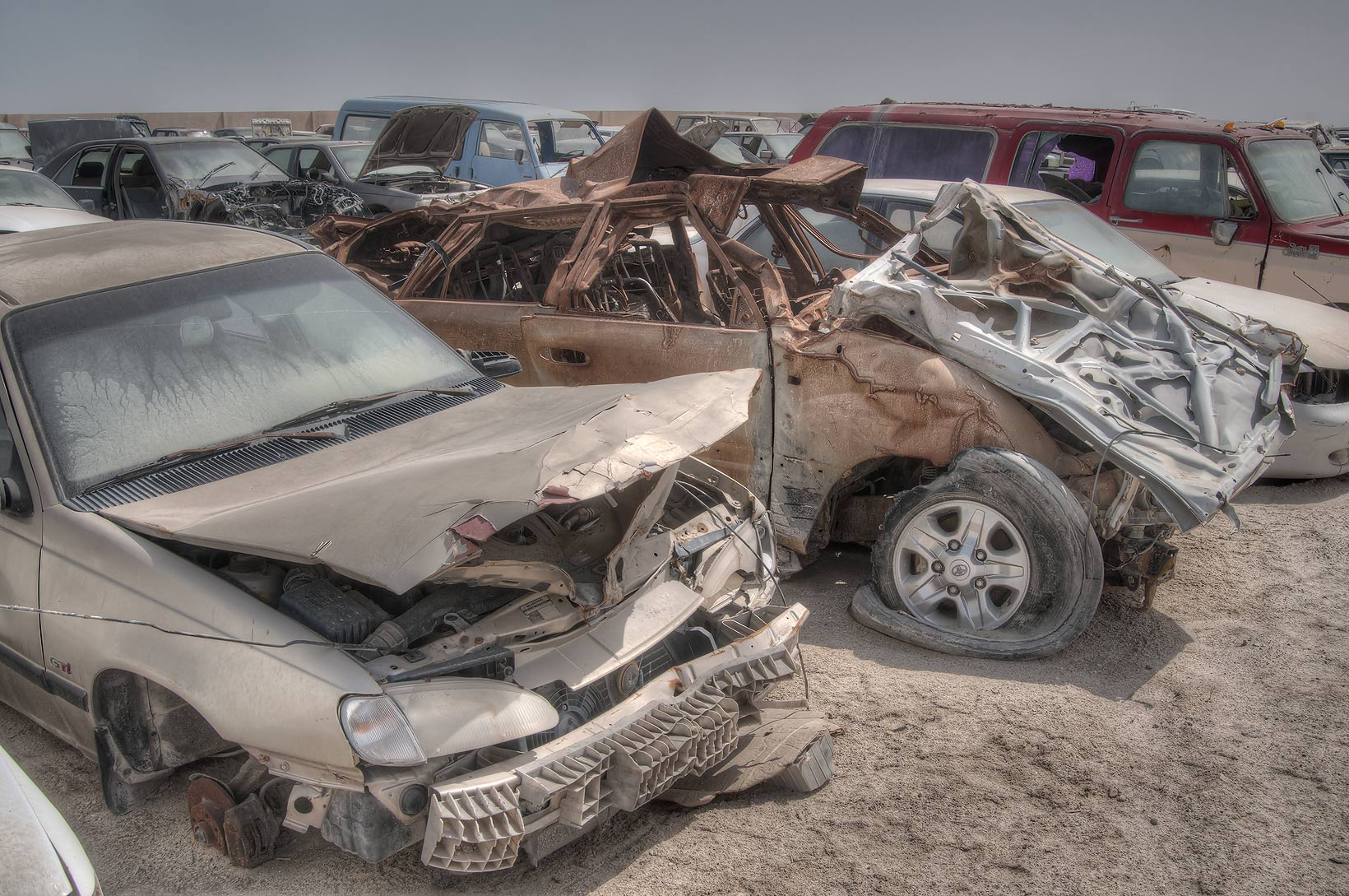Damaged cars in a junkyard north of Mesaieed (Umm Said). Qatar