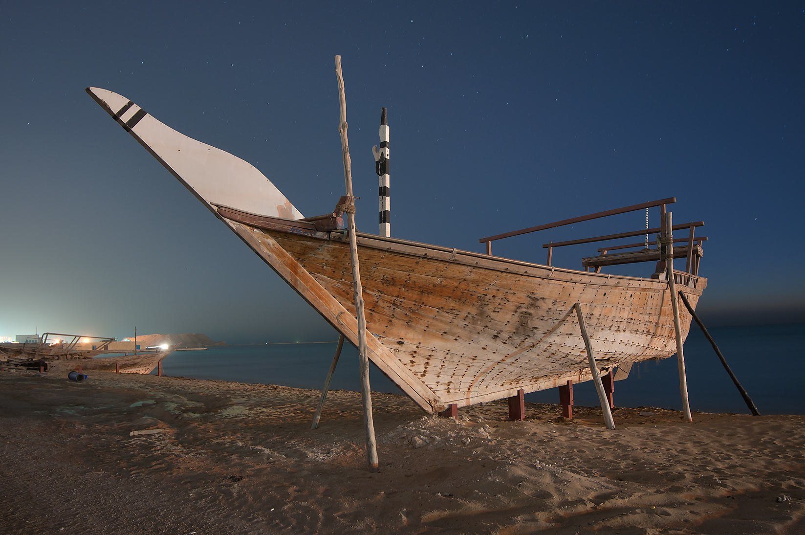 Beached dhow boat at early morning. Al Wakrah, Qatar