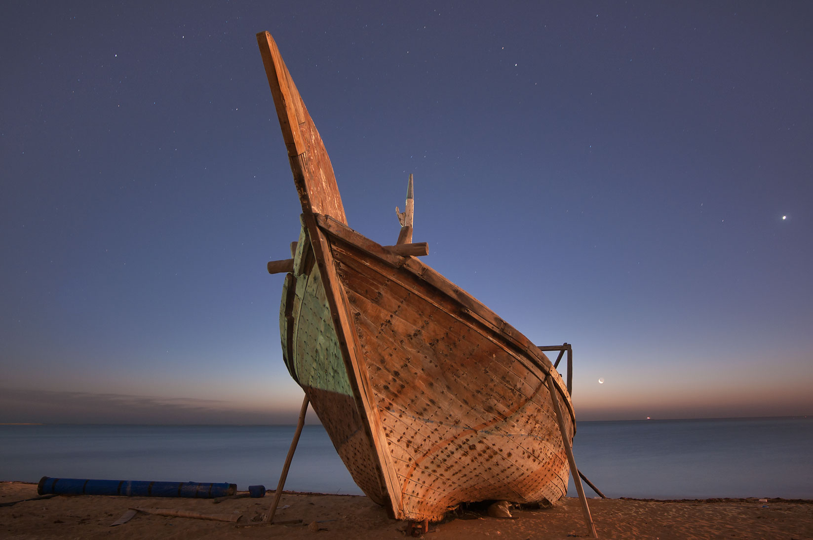 Beached dhow boat at morning dusk. Al Wakrah, Qatar