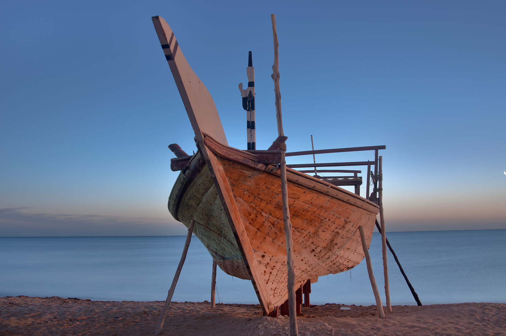 Beached dhow boat at sunrise. Al Wakrah, Qatar