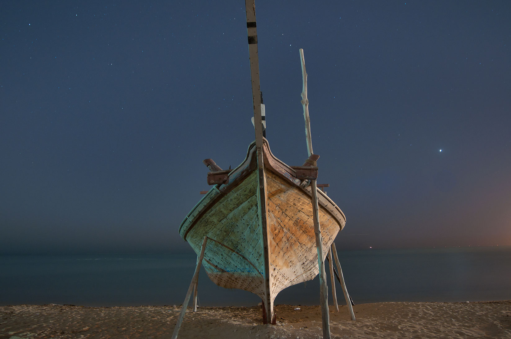 Hull of a fishing boat in heritage village. Al Wakrah, Qatar