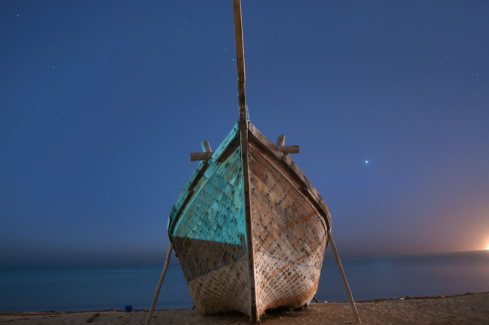 Fishing boat on a beach at morning dusk. Al Wakrah, Qatar