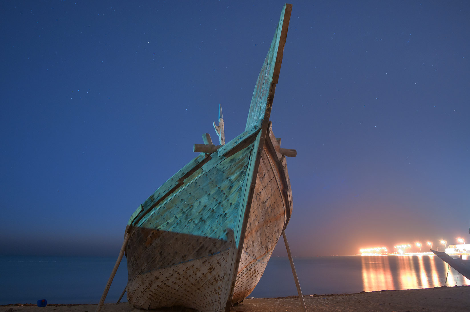 Fishing boat on a beach near heritage village at morning dusk. Al Wakrah, Qatar