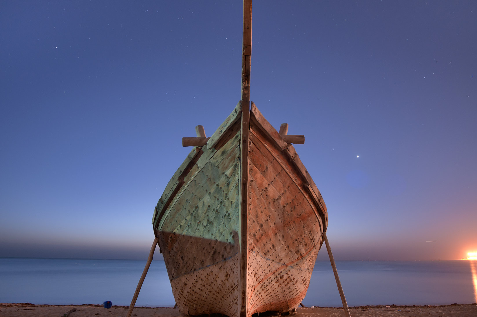 Hull of a beached fishing boat near heritage village. Al Wakrah, Qatar