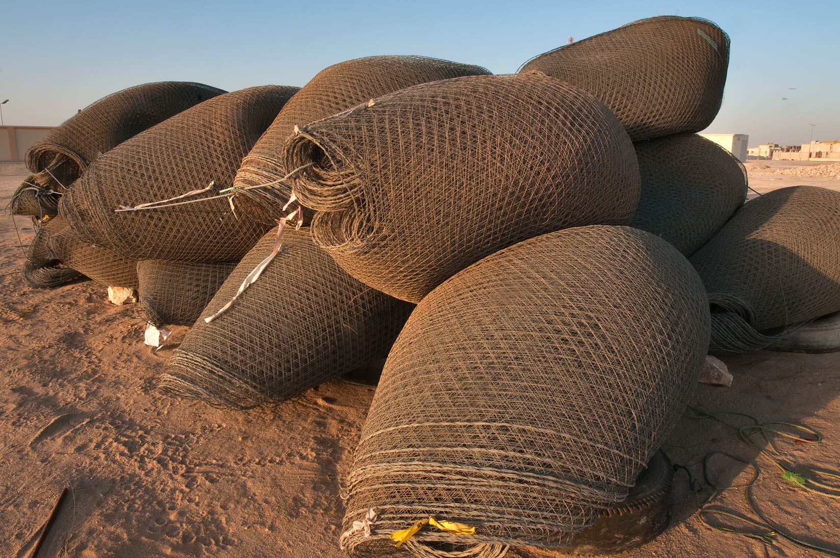 Folded fish traps (gargoor) at sunrise. Al Wakrah, Qatar