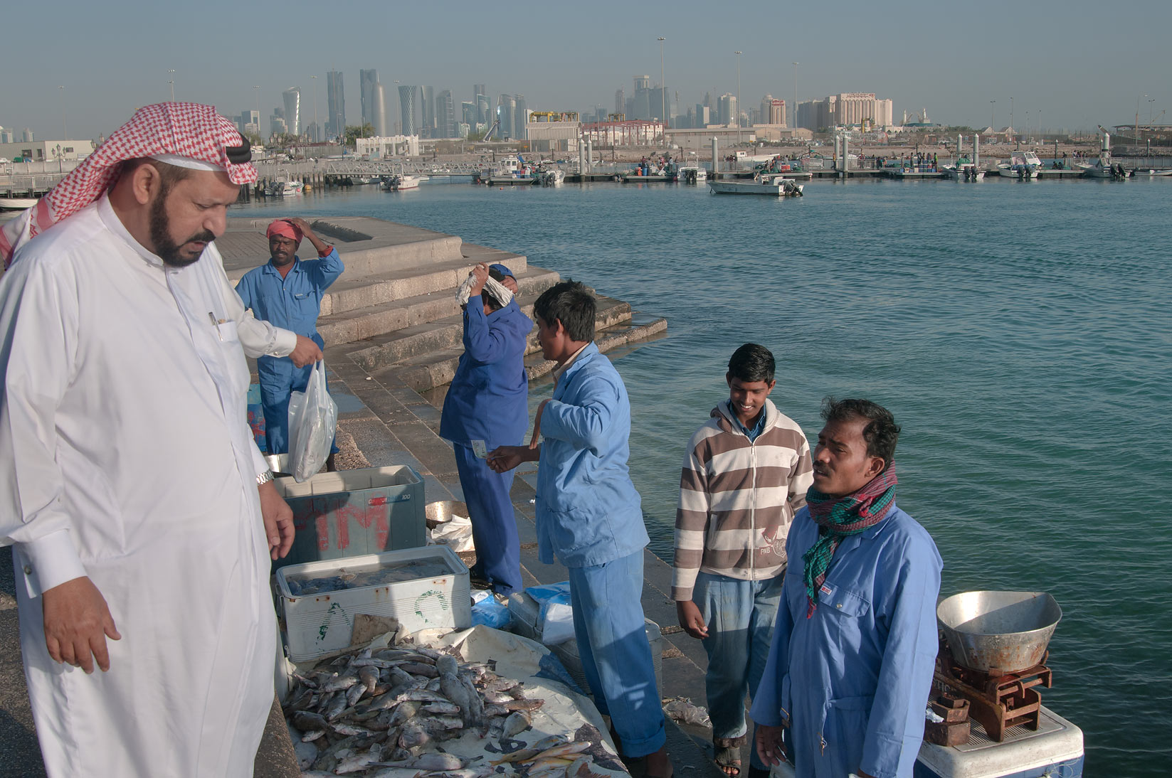 Shopping at Corniche Fresh Fish Sold Market. Doha, Qatar