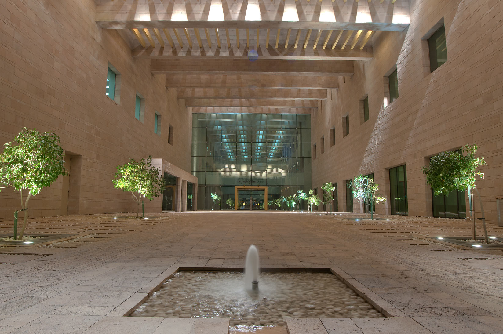 Entrance of Carnegie Mellon University in Education City campus at evening. Doha, Qatar