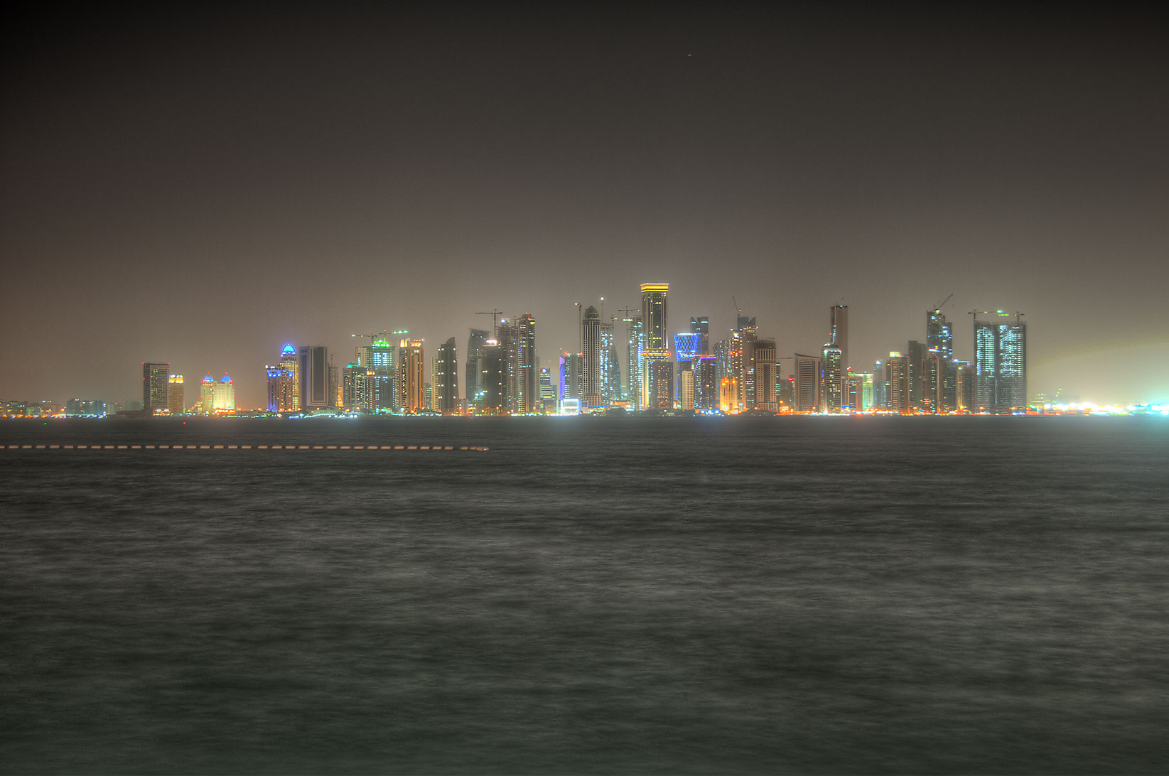 Northern area of West Bay from a beach south of...Hotel at windy weather. Doha, Qatar