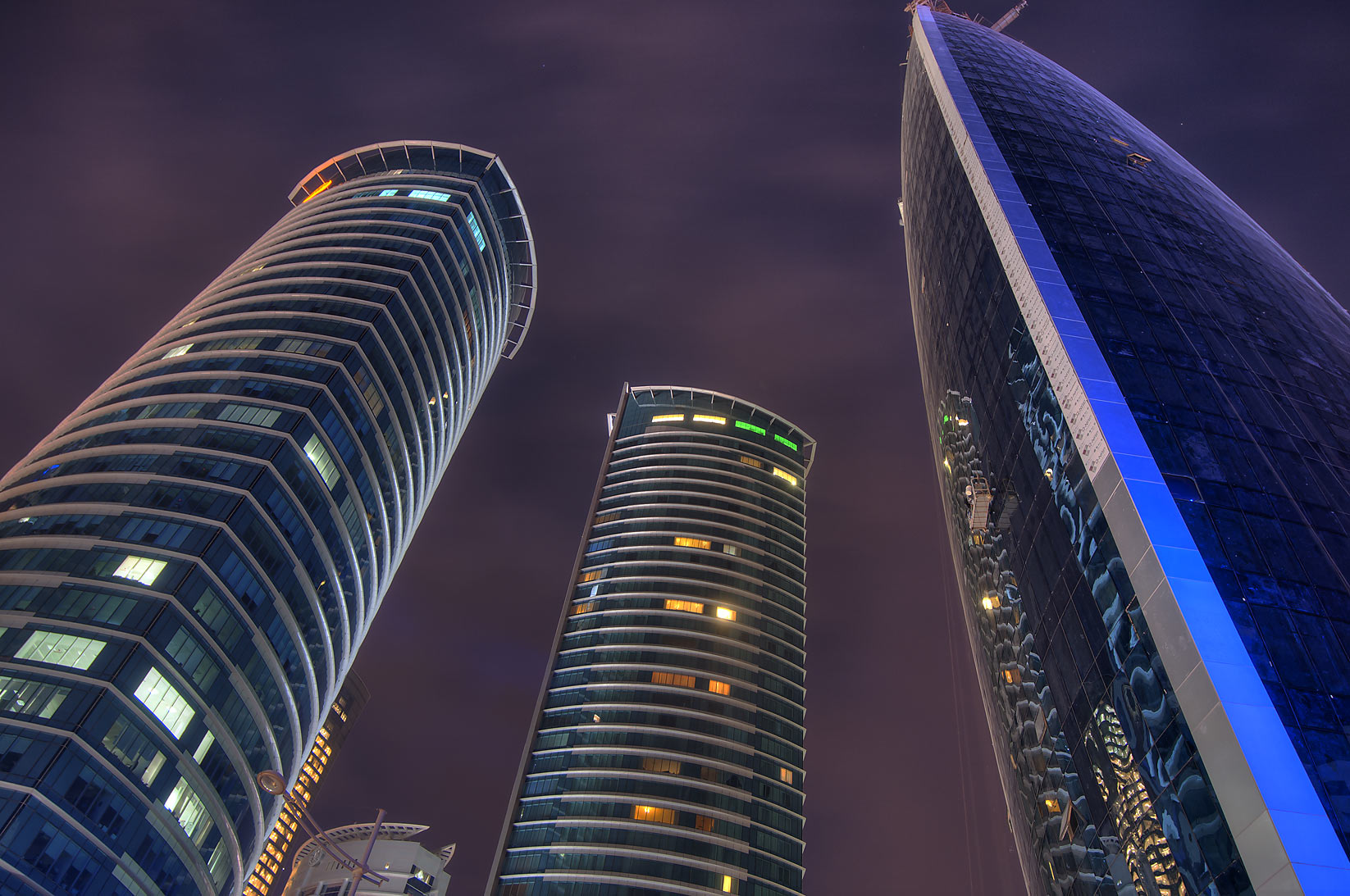Woqod and twin Al Fardan towers in West Bay at early morning. Doha, Qatar