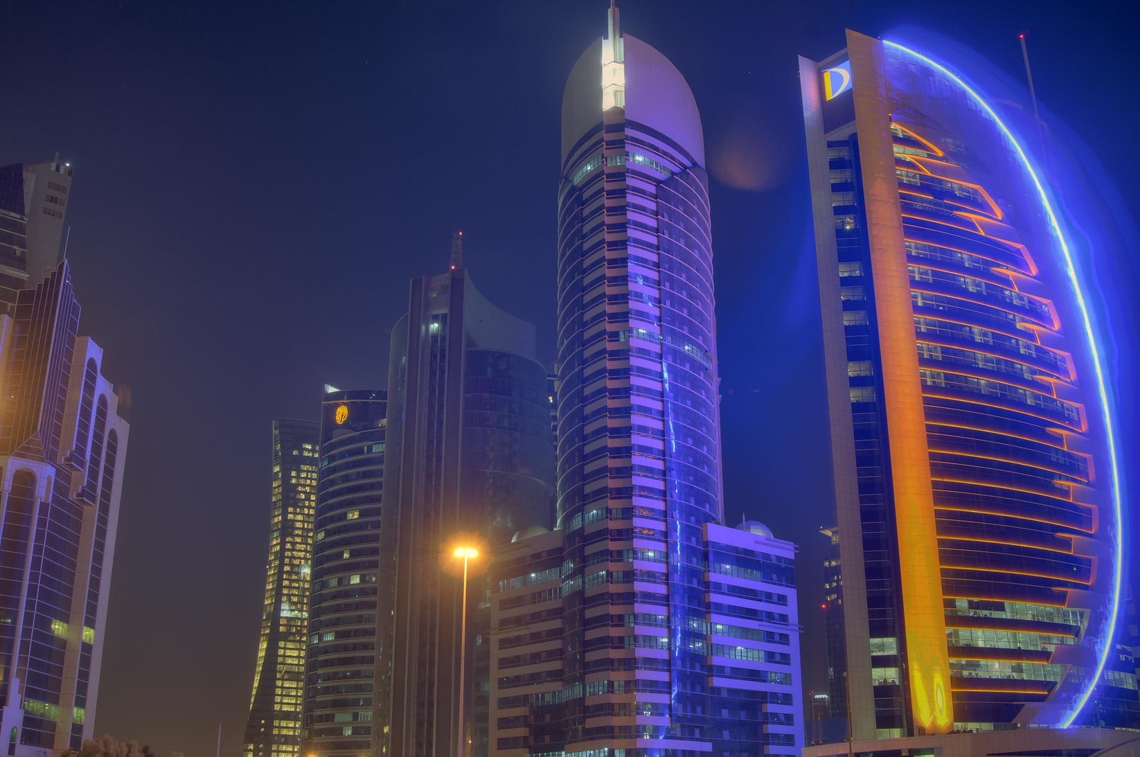 Ramez Tower and Doha Bank in West Bay from Sheraton Roundabout. Doha, Qatar