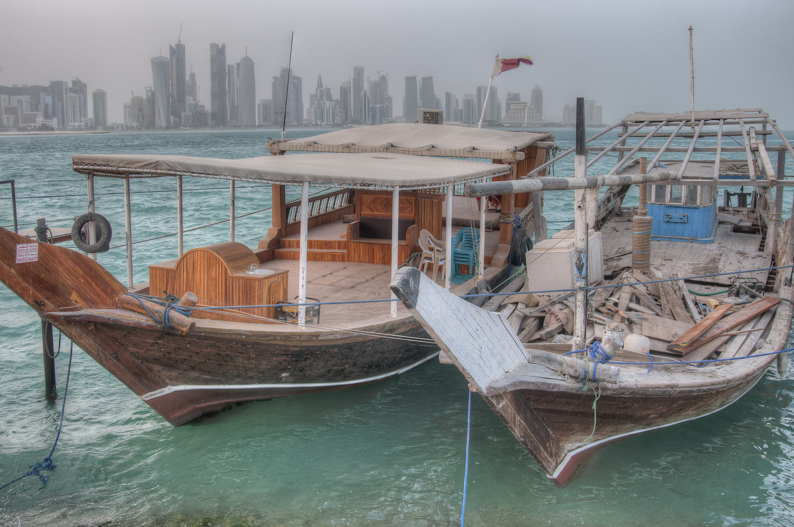 Two dhow boats in fishing harbor. Doha, Qatar