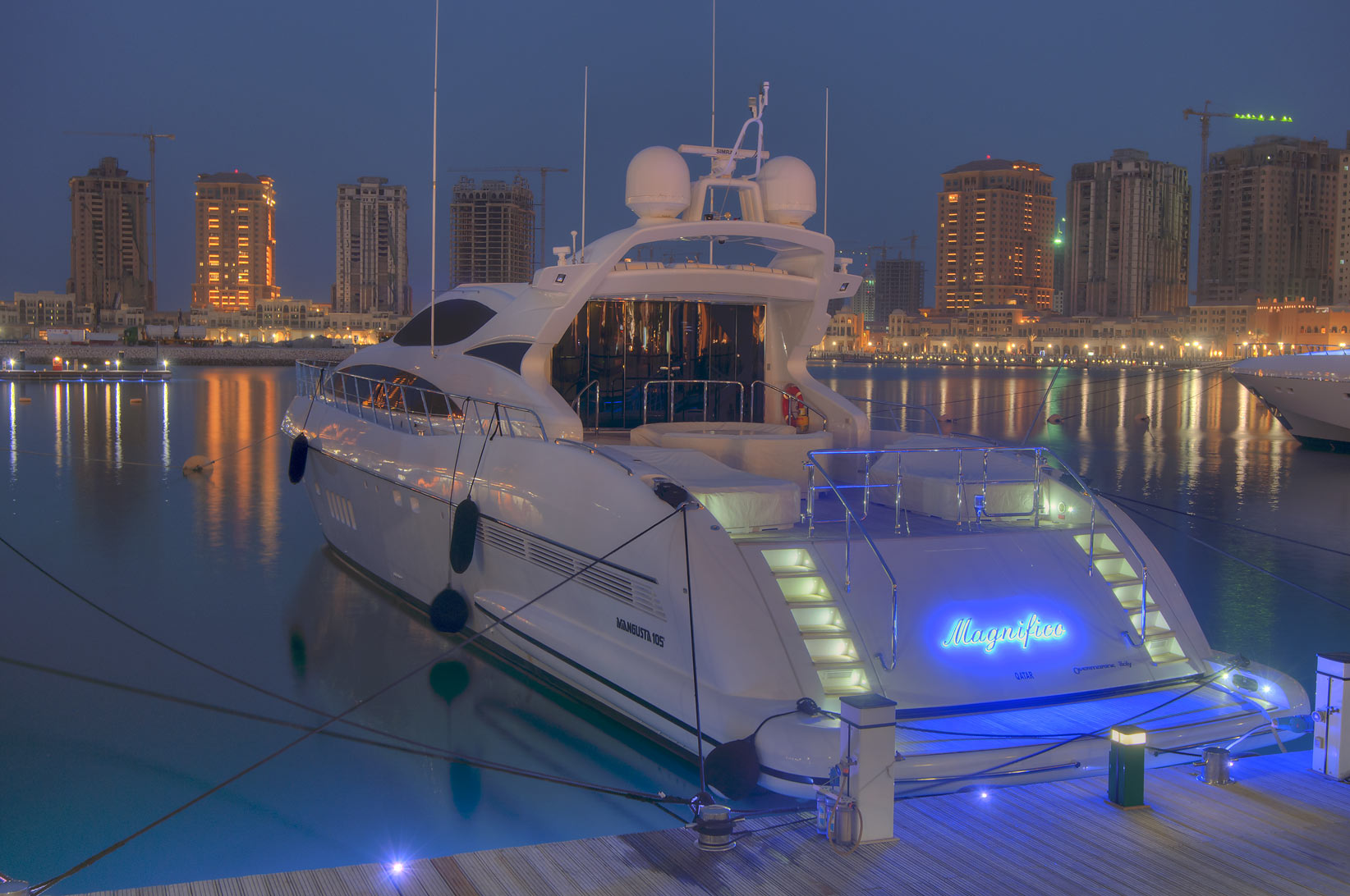 Yacht in a marina of Porto Arabia in Pearl Qatar development at evening. Doha, Qatar