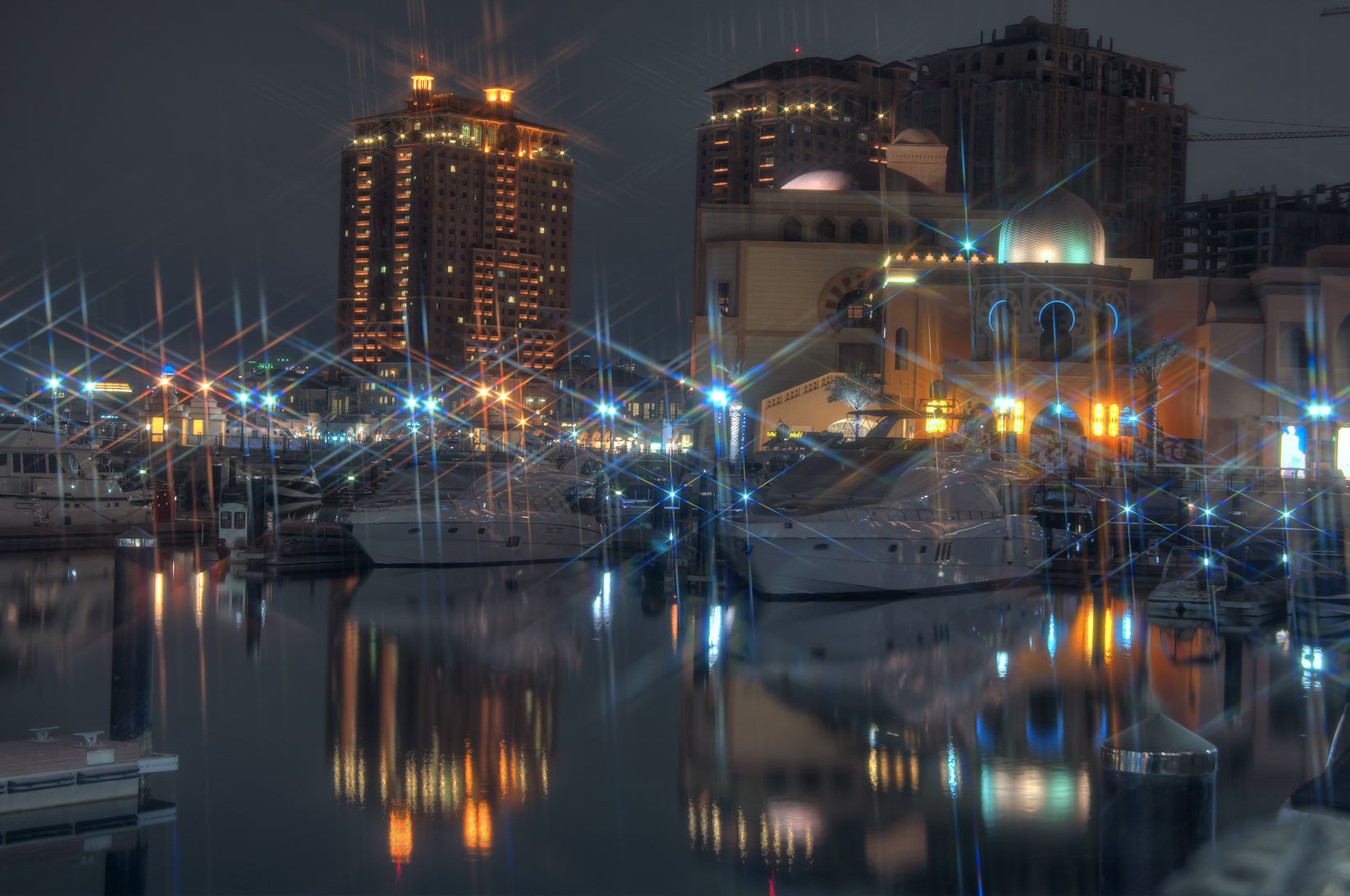 Lights in marina of Porto Arabia in Pearl Qatar development. Doha, Qatar