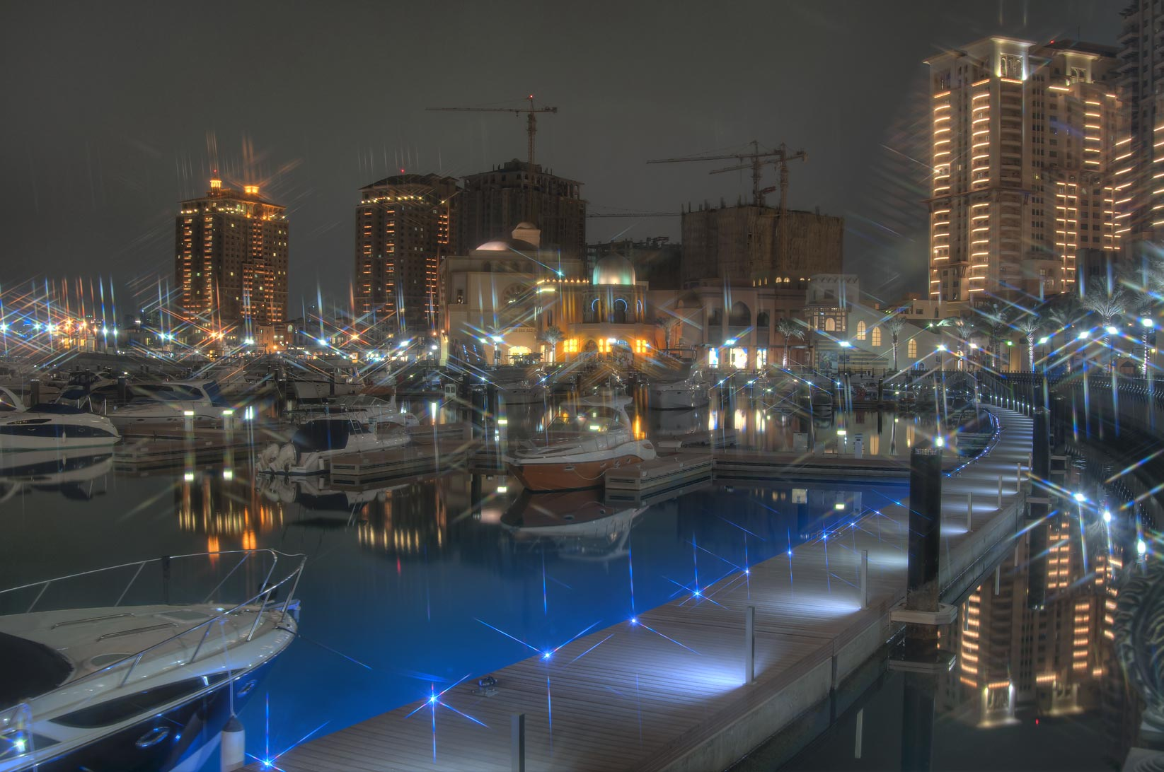 Boardwalk of marina of Porto Arabia in Pearl Qatar development. Doha, Qatar