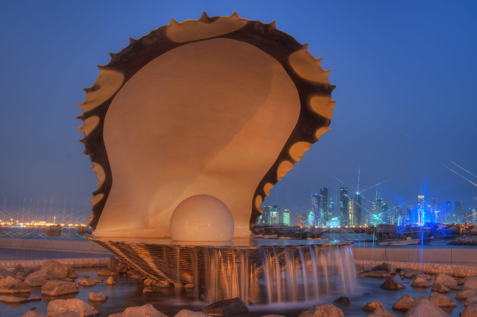 Oyster and Pearl Sculpture fountain on Corniche...with lights turned off. Doha, Qatar