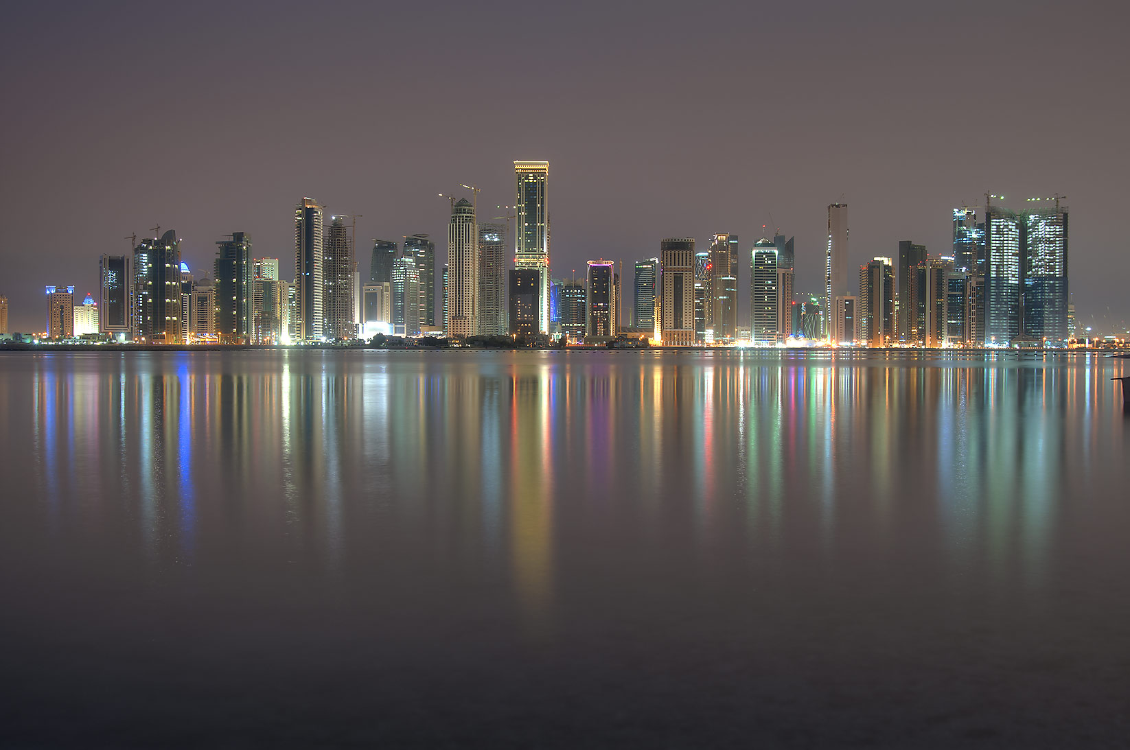 Northern area of West Bay from a beach south of...Hotel at night. Doha, Qatar