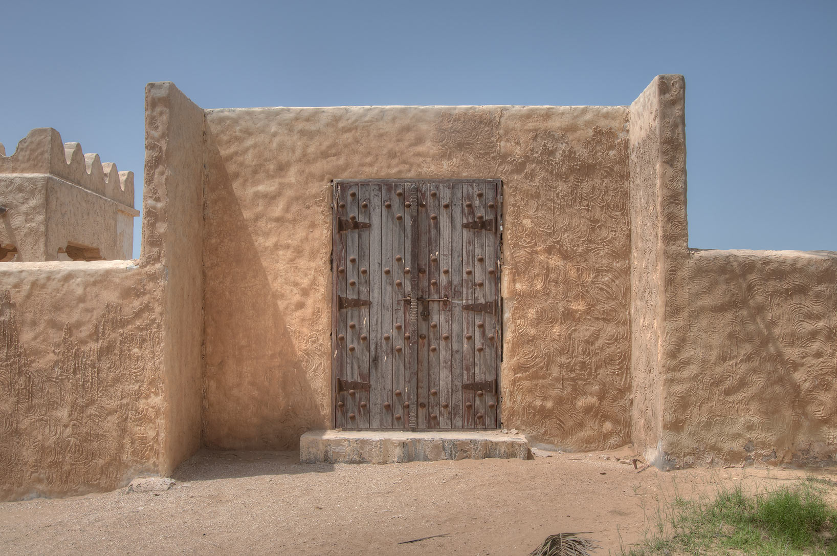Wooden gate in Film City built for a television...area, north from Zekreet. Qatar